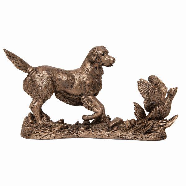Gundog retriever flushing out a pheasant